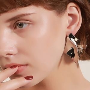 Silver toned abstract wrinkled stud earrings